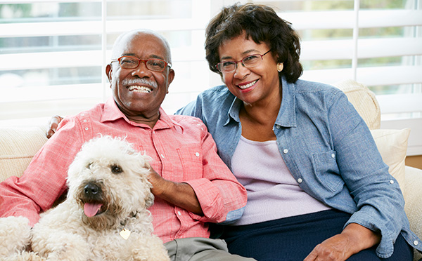 Couple sitting and smiling with dog